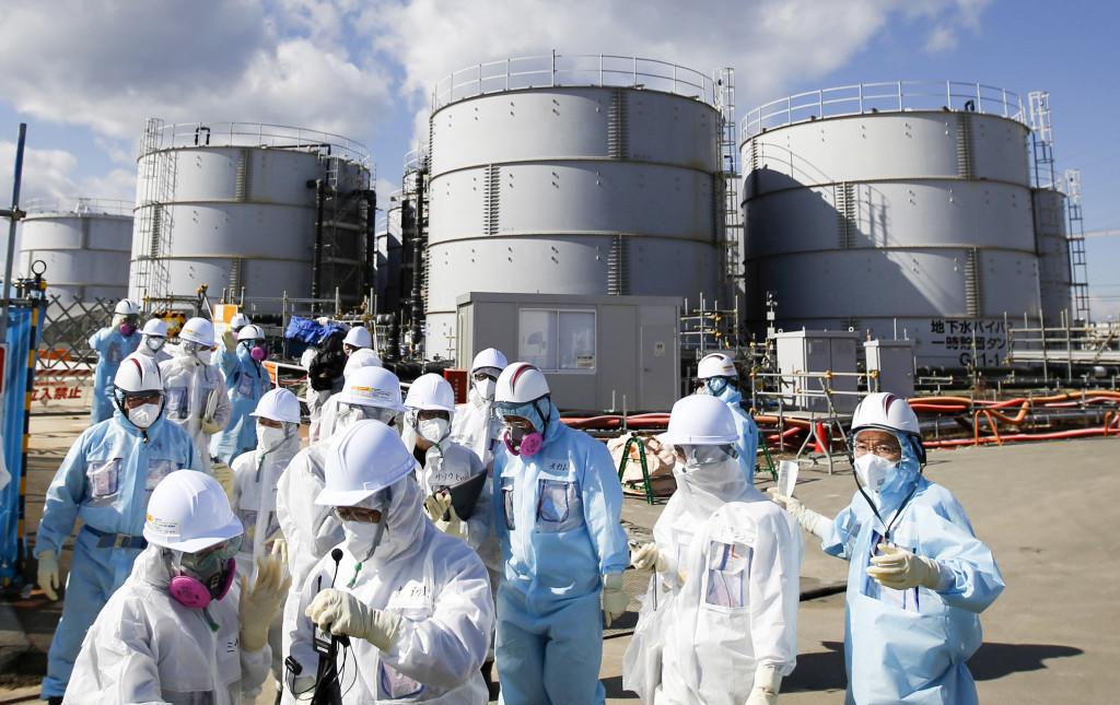 Journalister besöker kärnkraftverket i Fukushima fem år efter katastrofen. Foto: Toru Hanai/Pool Photo via AP/TT.